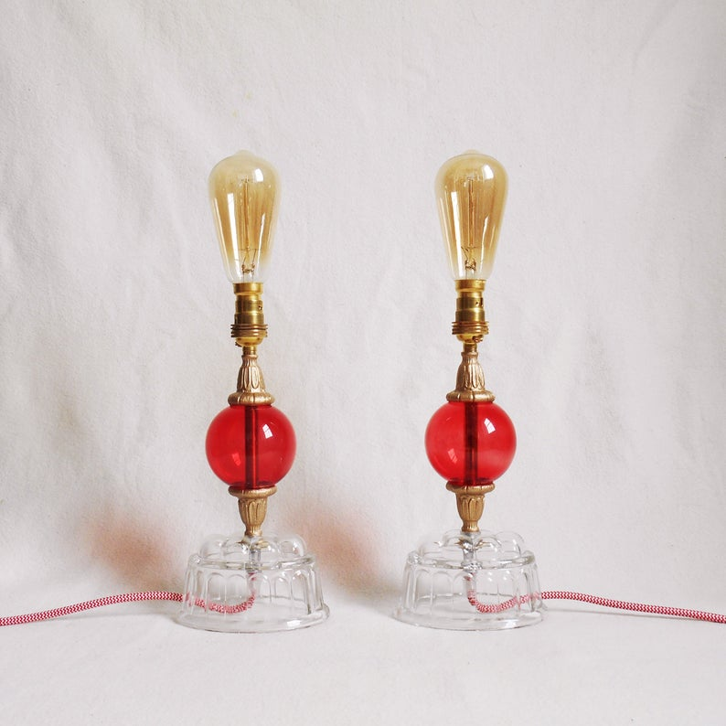 A pair of vintage jelly mould and red glass table lamps