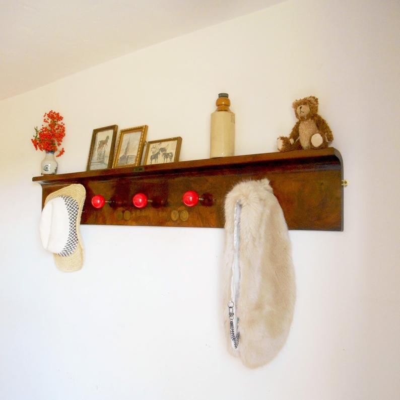 Antique coat rack made from a piano lid & red snooker balls by Fiona Bradshaw Designs