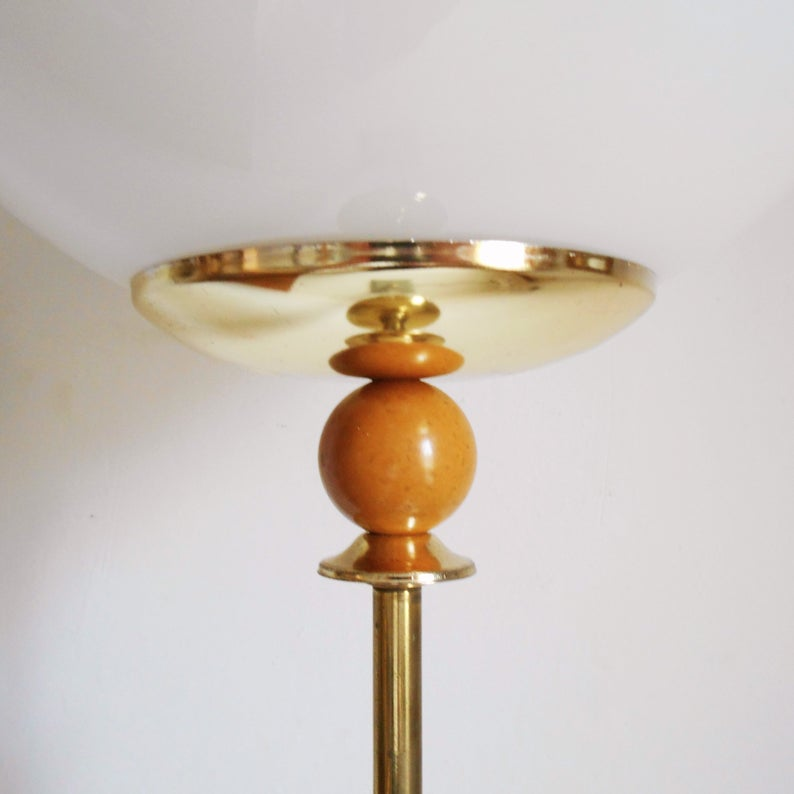A vintage brass floor lamp with a large glass dome by Fiona Bradshaw Designs