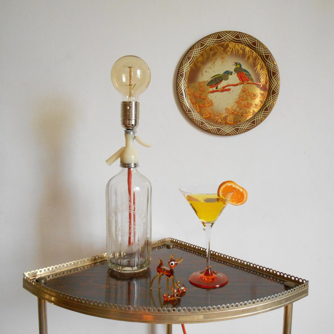 Vintage soda syphon lamp with a zingy orange braided cable by Fiona Bradshaw Designs