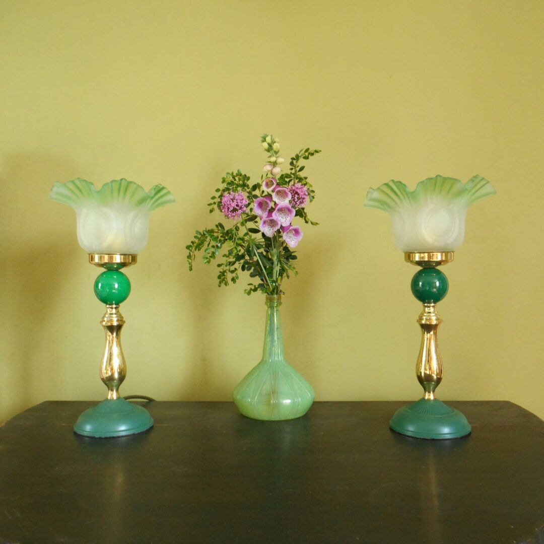A pair of Art Deco style lamps with frilly green glass shades by Fiona Bradshaw Designs