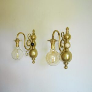 A pair of large solid brass wall lamps with unique features by Fiona Bradshaw Designs
